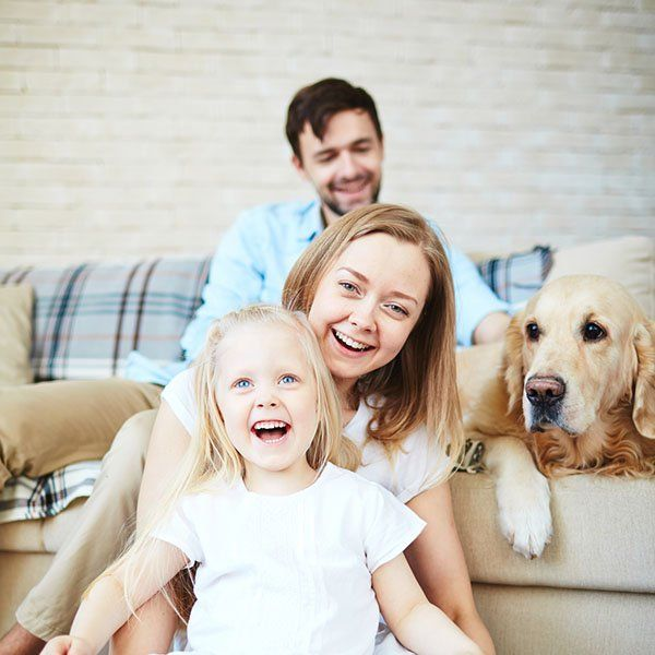 happy family and dog enjoying their home