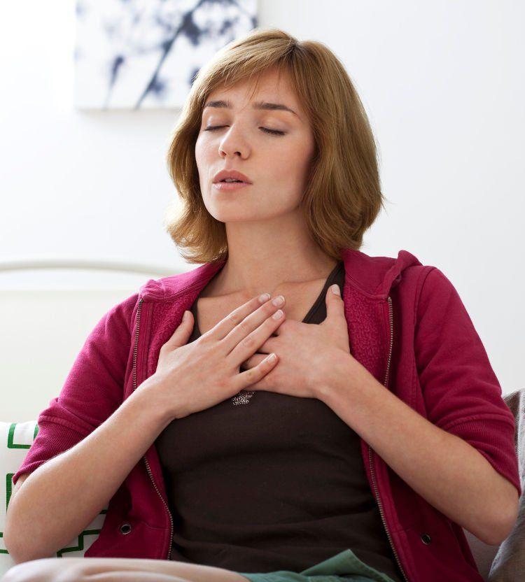 woman taking a deep breath of clean air.